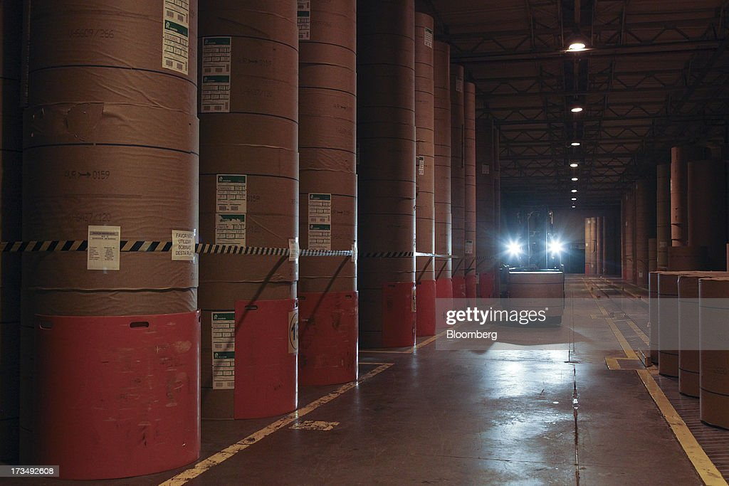 A forklift carries a roll of paper to be used in the printing process of the O Globo newspaper at the press park in Rio de Janeiro, Brazil, on Friday, July 12, 2013. Brazil economists raised their 2014 benchmark interest rate forecast to the highest all year, as policy makers work to slow inflation that has curbed consumption and confidence in the world's second-biggest emerging market. Photographer: Dado Galdieri/Bloomberg via Getty Images