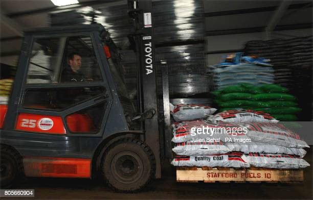A forklift carries bags of coal in Ahern Fuels in Urlingford CoKilkenny on Budget day when the Government has signalled it will introduce a carbon...