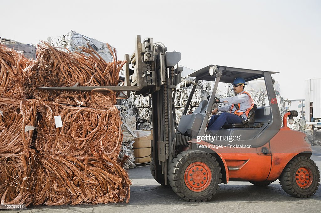 Forklift driver working at recycling plant : Stock Photo
