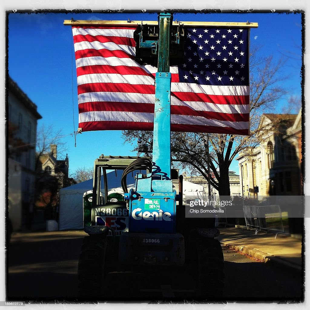 A forklift holds an American flag suspended during a campaign rally with U.S. President Barack Obama in State Capitol Square November 4, 2012 in Concord, New Hampshire. With only two days left in the presidential election, Obama and his opponent, former Massachusetts Gov. Mitt Romney are stumping from one 'swing state' to the next in a last-minute rush to persuade undecided voters.