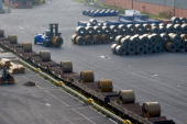 A forklift loads steel rolls on to a railway cart ready for transportation at an ArcelorMittal steel plant in Bremen Germany on Wednesday Nov 4 2009...