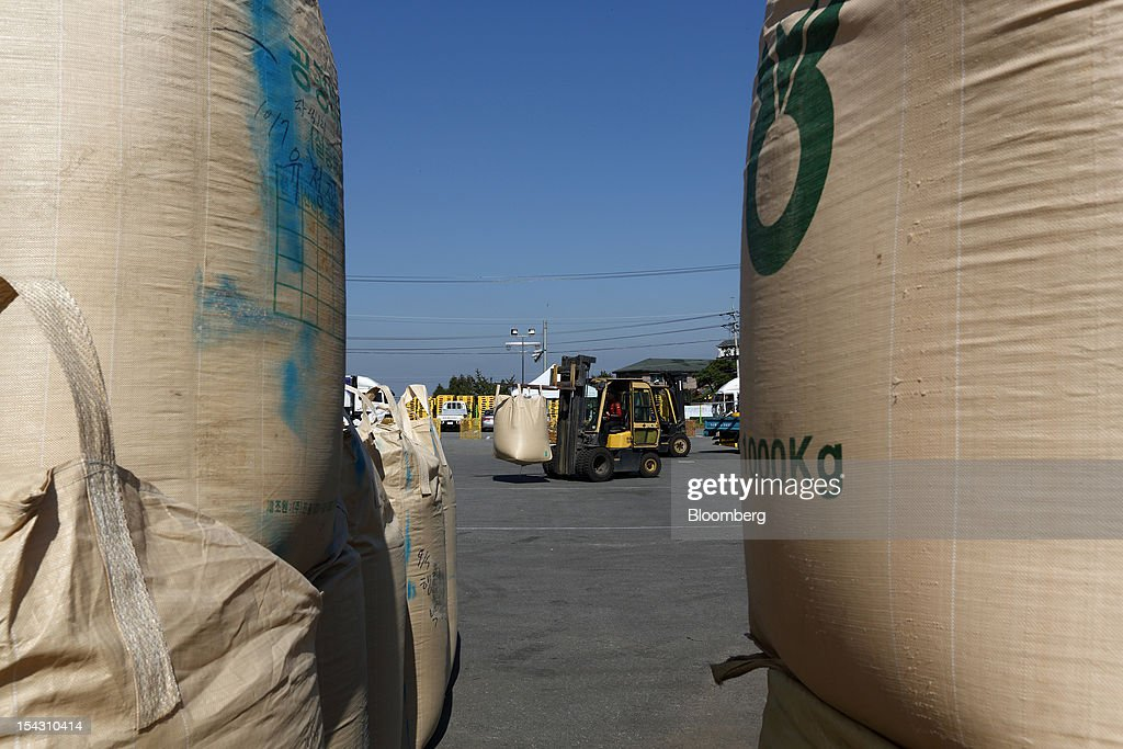 A forklift moves a sack of rice at Icheon Rice Center in Icheon, South Korea, on Thursday, Oct. 11, 2012. South Korea will boost production of rough rice to 5.801 million metric tons in the year that starts Nov. 1, compared with an estimated 5.616 million a year earlier, the U.S. Department of Agriculture's Foreign Agricultural Service said on Aug. 2 in a report posted on its website. Photographer: SeongJoon Cho/Bloomberg via Getty Images