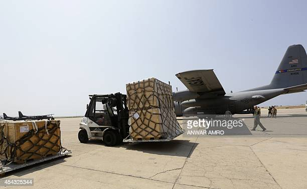 A forklift moves a shipment of weapons that was delivered by a US air force plane on August 29 2014 at a Lebanese military base at Beirut...