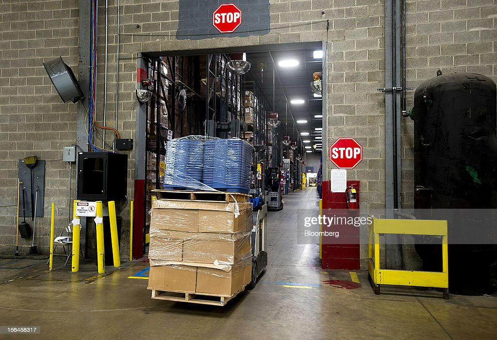 A forklift moves finished products at the Newell Rubbermaid Inc. warehouse in Mogadore, Ohio, U.S., on Thursday, Nov. 15, 2012. The U.S. Federal Reserve is scheduled to release monthly industrial production data on Nov. 16. Photographer: Ty Wright/Bloomberg via Getty Images