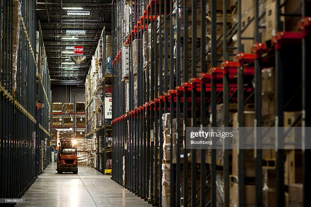 A forklift moves materials at the Newell Rubbermaid Inc. warehouse in Mogadore, Ohio, U.S., on Thursday, Nov. 15, 2012. The U.S. Federal Reserve is scheduled to release monthly industrial production data on Nov. 16. Photographer: Ty Wright/Bloomberg via Getty Images