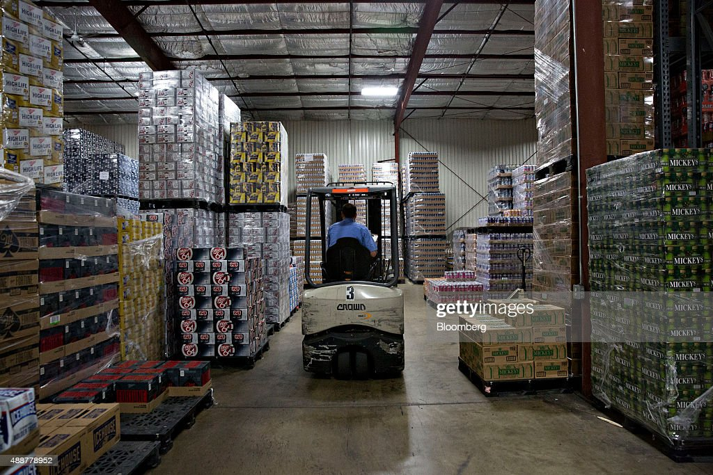 A forklift moves through the warehouse of Baumgarten Distributing Co. as customer orders are prepared in Peoria, Illinois, U.S., on Thursday, Sept. 17, 2015. Anheuser-Busch InBev NV unveiled plans to acquire SABMiller Plc yesterday, a deal that may cost the Budweiser brewer more than $100 billion as it seeks to unite the world's two biggest beermakers. Photographer: Daniel Acker/Bloomberg via Getty Images