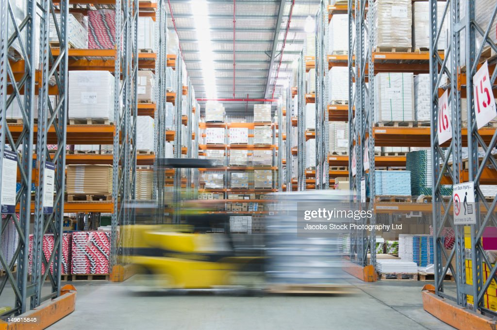 Forklift on the move in warehouse