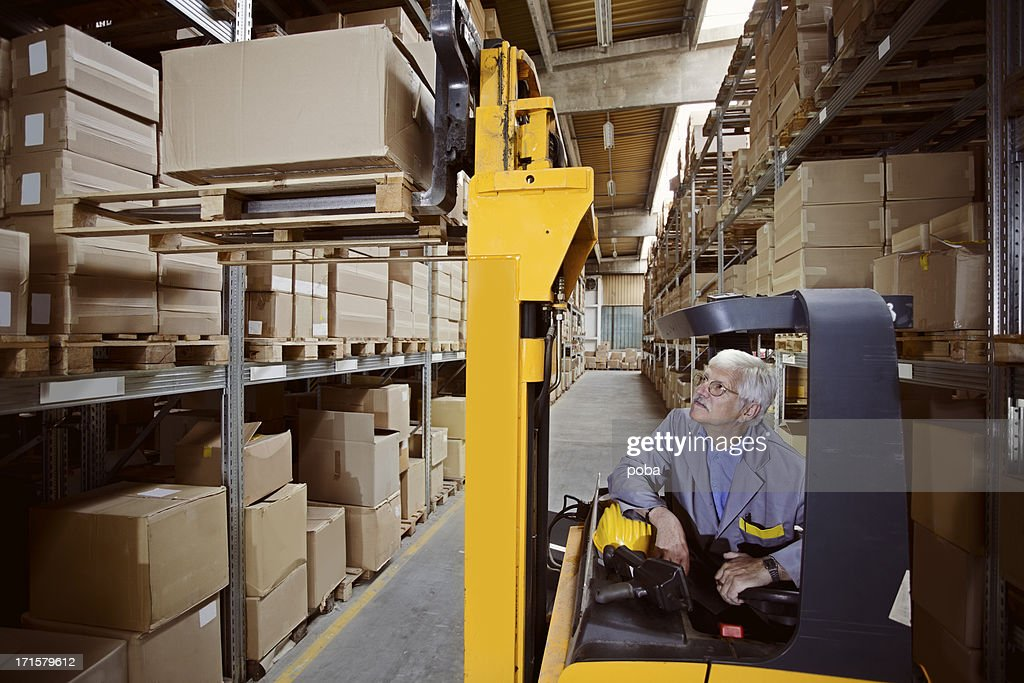 forklift operator at warehouse Loading, lifting cardboard boxes