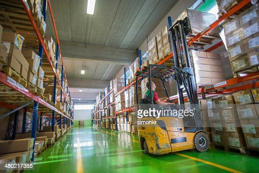 Forklift Operator Loading A Palette