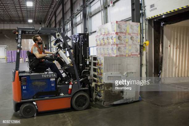 A forklift operator loads boxes of Huggies brand diapers onto a truck at the KimberlyClark Corp manufacturing facility in Paris Texas US on Oct 27...