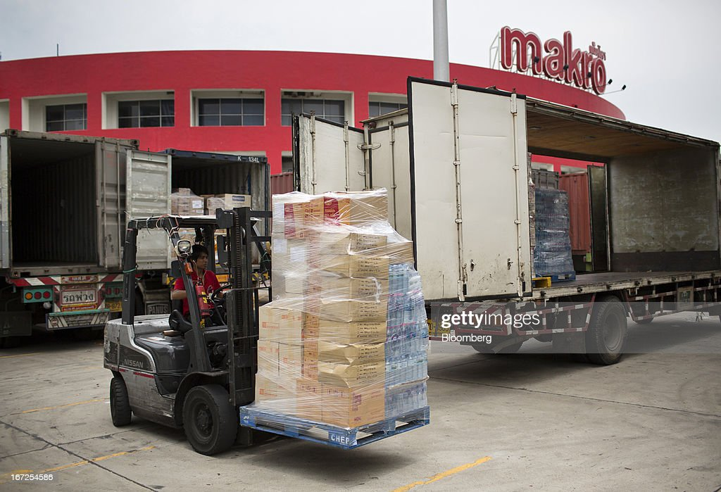 A forklift operator offloads goods from a truck outside a Makro store, operated by Siam Makro Pcl, in Bangkok, Thailand, on Tuesday, April 23, 2013. Billionaire Dhanin Chearavanont's CP All Pcl, Thailand's 7-Eleven chain, offered to pay about $6.6 billion for discount retailer Siam Makro Pcl in the biggest takeover announced in Asia this year. Photographer: Brent Lewin/Bloomberg via Getty Images