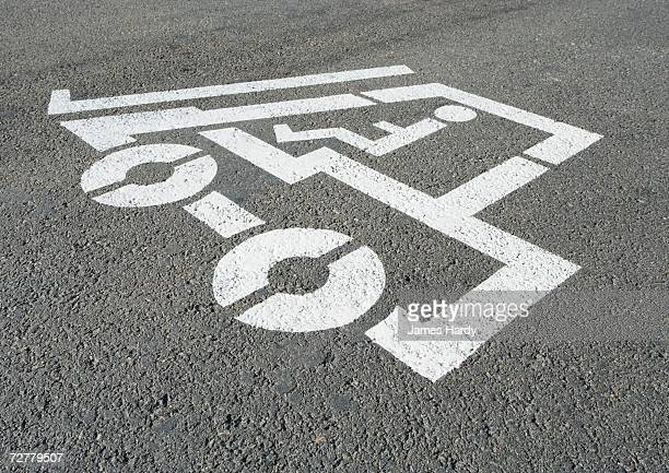 Forklift pictogram stenciled on asphalt