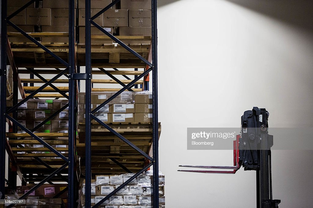 A forklift prepares to move a pallet of beauty products at the Mary Kay Inc. regional distribution facility in Dallas, Texas, U.S., on Tuesday, Aug. 6, 2013. About 350,000 Mary Kay businesses were started globally in the past year, including 90,000 in the first quarter of 2013, according to a company press release. Photographer: T.J. Kirkpatrick/Bloomberg via Getty Images