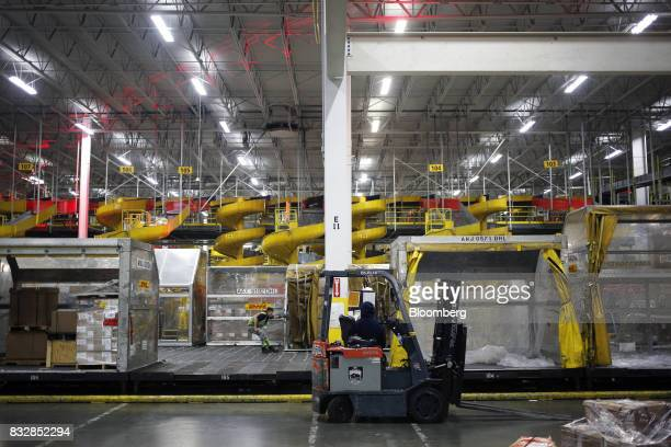 A forklift sits parked at the DHL Worldwide Express hub of Cincinnati/Northern Kentucky International Airport in Hebron Kentucky US on Wednesday Aug...