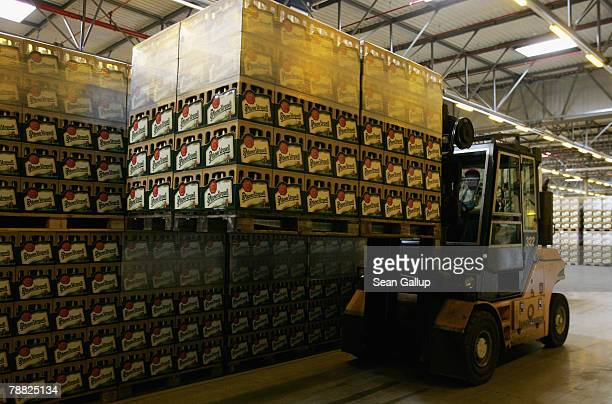 A forklift stacks cases of freshlybrewed PilsnerUrquell lager beer at the Prazdroj brewery November 15 2006 in Pilsen Czech Republic Prazdroj along...