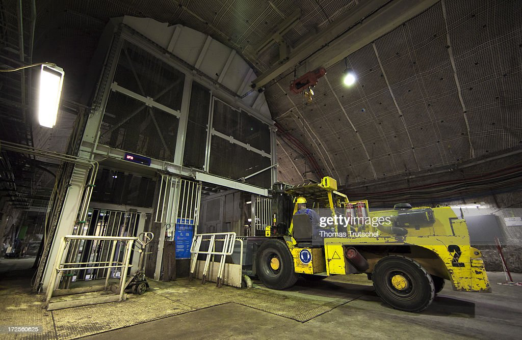 A fork-lift truck carry material out of the elevator of Schacht 1 in Gorleben Mine on July 3, 2013 in Gorleben, Germany. The German Bundestag has agreed on June 28, 2013 to allow a commission of experts to launch a search for a new nuclear waste disposal site. The law ends radioactive transports to the controversial site in Gorleben for the time being. Under the terms of the measure, the government will commission a group of 30 experts to oversee the search. The panel, comprised of members of parliament, scientists and representatives from various interest groups, must present a list of criteria for the search by 2015. It must convene publicly before approving stipulations for the selection process.