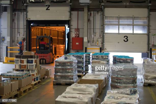 A forklift truck loads paint into a truck inside the distribution warehouse at the PPG Industries Inc paints and coatings factory in Amsterdam...