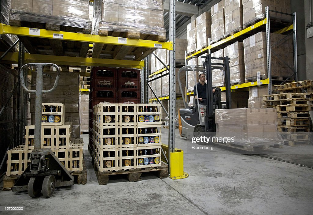 A fork-lift truck moves boxes of Page 24 beer, produced by the brewer Brasserie Saint Germain around the storage area at the brewery in Aix-Noulette, in France, on Monday, Nov. 26, 2012. Producers of beer in France, for instance, say any development plans they had have been 'nipped in the bud' by Hollande's plan to boost the tax on the drink next year. Photographer: Balint Porneczi/Bloomberg via Getty Images