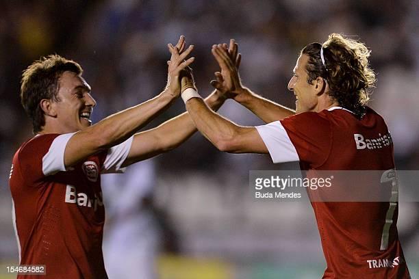 Forlan and Dagoberto of Internacional celebrate a scored goal during a match between Vasco and Internacional as part of the brazilian championship...