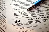 W-4 form and a pen. Tax season