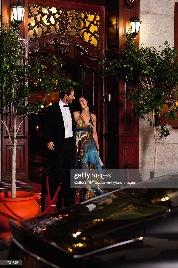 Formal couple leaving party together : Stock Photo