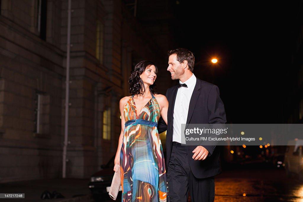 Formal couple walking on city street