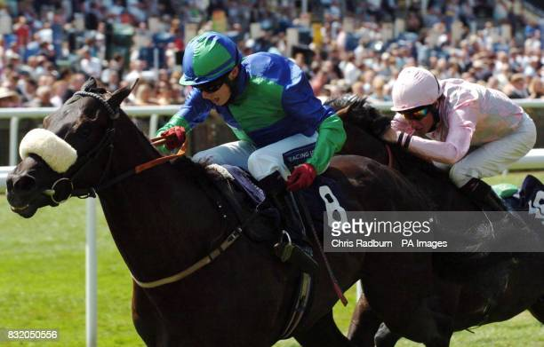 Formal Decree ridden by Jamie Spencer wins the Blandford Bloodstock Joss Collins Stakes ahead of Porters ridden by Richard Hughes at Newmarket...