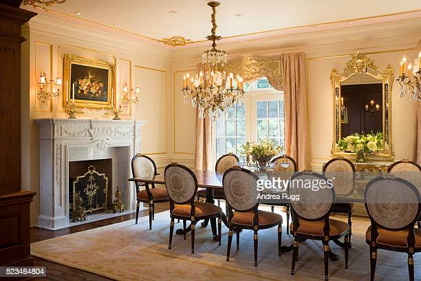 Formal dining room with white marble fireplace mantel