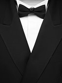 Formal dinner jacket with black bow tie and white shirt. Copy space.Click on the link below to see more of my party images.