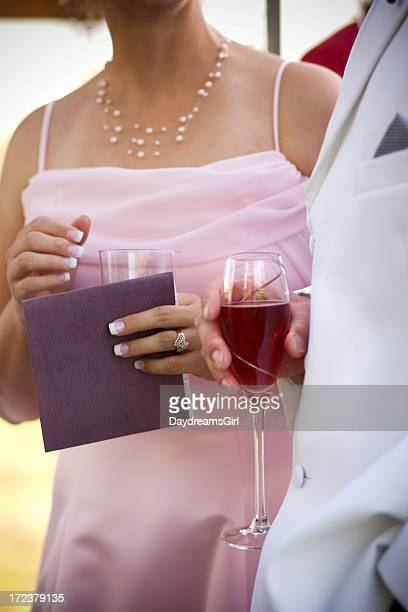 Formal Dressed Man and Woman Standing Holding Wine Glasses