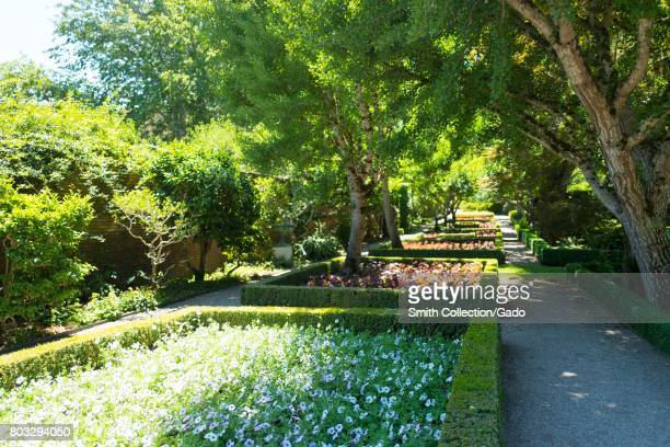 Formal garden with flowers set among hedges designed to keep out rabbits at Filoli a preserved country house formal garden and estate operated by the...