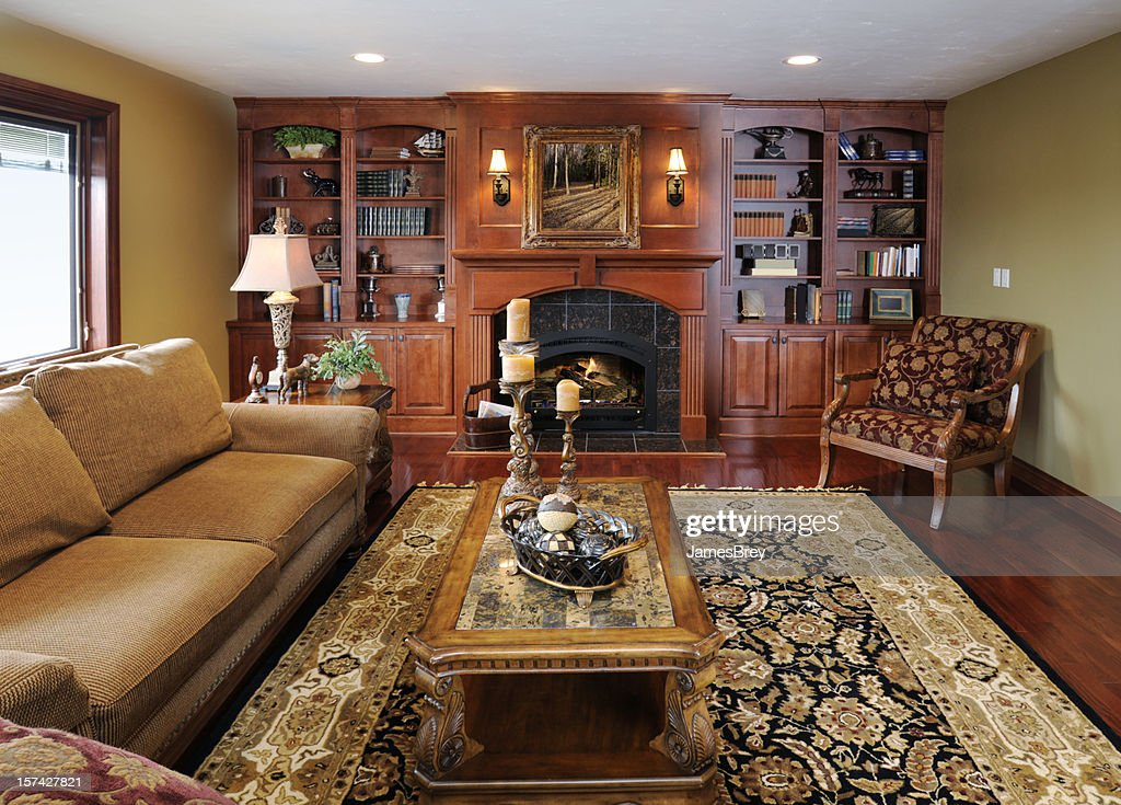 Formal Living Room Home Interior Hardwood Cabinetry Fireplace Persian Rug Stock Photo