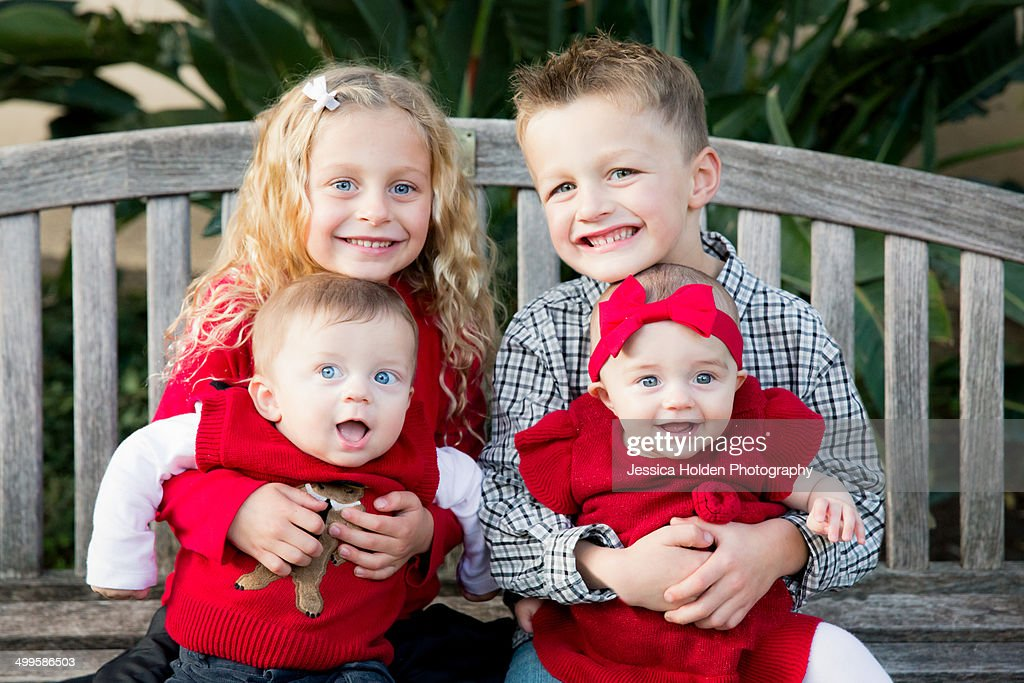 Formal Portrait of Two Sets of Twins : Stock Photo