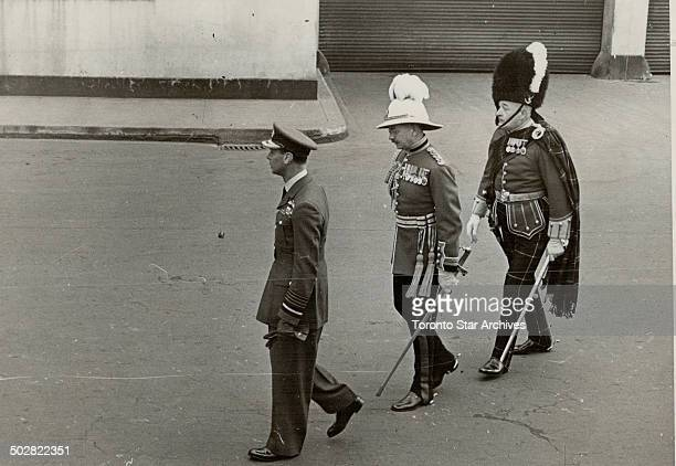 Formality was the word at Vancouver The King wore his air marshal's uniform when he marched with these officers to inspect a guard drawn from the 5th...