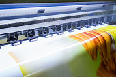 Format large inkjet printer working on yellow vinyl banner