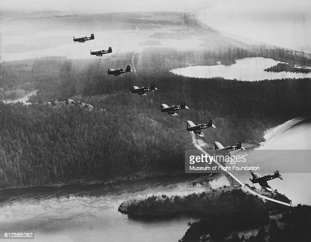 A formation of eight U S Navy Vought F4U Corsair fighters fly over the north end of Whidbey Island in the state of Washington in 1950 | Location over...