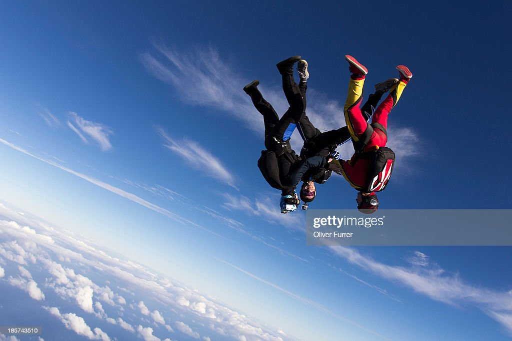 Formation skydivers free falling upside down
