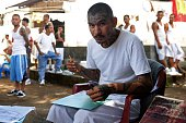A former MS13 gang member attends a drawing and painting class at the Apanteos prison in Santa Ana 66 km west of San Salvador on July 15 2016...
