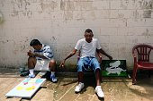 Former MS13 gang members attend a drawing and painting class at the Apanteos prison in Santa Ana 66 km west of San Salvador on July 15 2016 Apanteos...