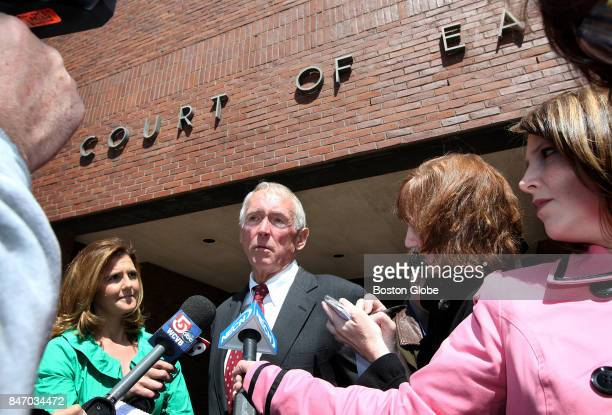 Former 1st assistant DA John Kivlan answers questions he leaves the District Court of East Norfolk in Quincy Mass on April 15 after testifying in a...