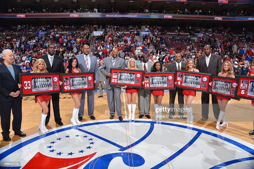 Former 76ers Reggie Johnson #33, Clemon Johnson #45, Earl Cureton #25, Franklin Edwards #14, Clint Richardson #4, Moses Malone #2, and Julius Erving #6 celebrate the 30th anniversary of the 1982-83 NBA Championship at the Wells Fargo Center on April 14, 2013 in Philadelphia, Pennsylvania.