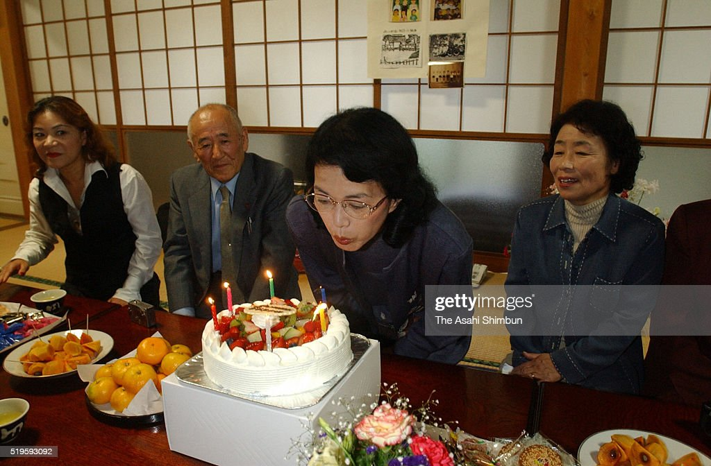 Former abductee by North Korea Fukie Hamamoto blows off candles on the birthday cake during a party on October 20 2002 in Obama Fukui Japan