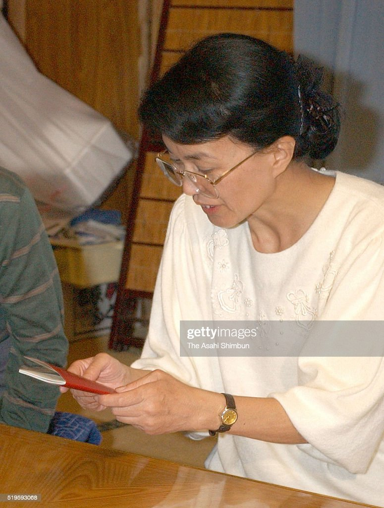 Former abductee by North Korea Fukie Hamamoto receives her passport at her home on October 18 2002 in Obama Fukui Japan