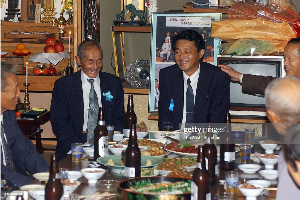 Former abductee by North Korea Yasushi Chimura talks with his family members at his home on October 17 2002 in Obama Fukui Japan
