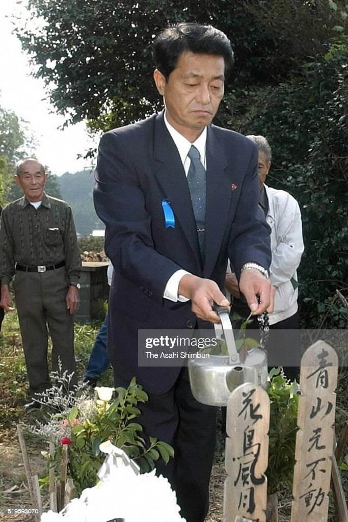 Former abductee by North Korea Yasushi Chimura visits his ancestors graves on October 18 2002 in Obama Fukui Japan