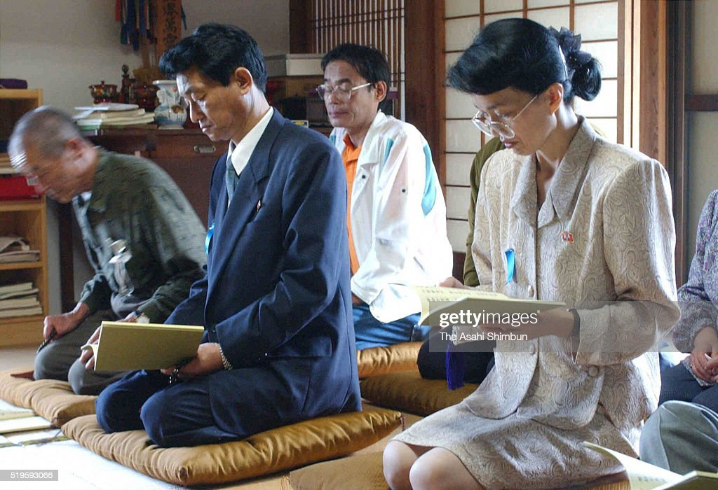 Former abductees by North Korea Yasushi Chimura and Fukie Hamamoto read sutra at the Hojuji Temple on October 18 2002 in Obama Fukui Japan