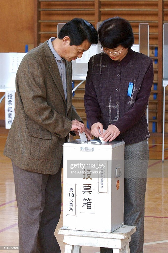 Former abductees by North Korea Yasushi Chimura and his wife Fukie cast their ballots at a polling station on April 13 2003 in Obama Fukui Japan