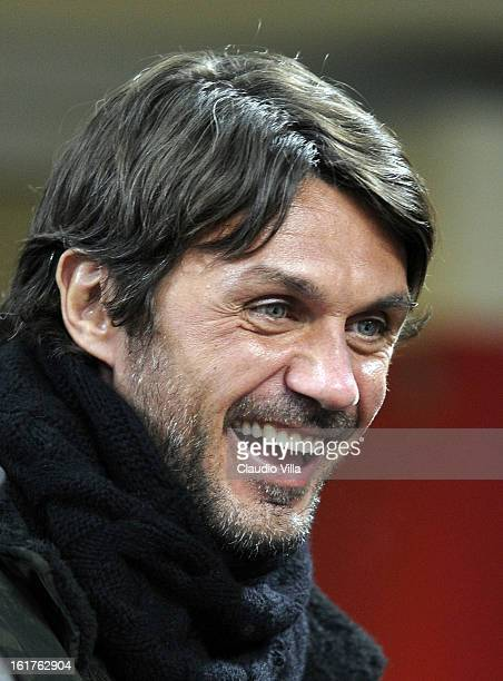 Former AC Milan defender Paolo Maldini smiles as he attends the Serie A match between AC Milan and Parma FC at San Siro Stadium on February 15 2013...