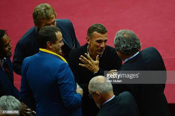 Former AC Milan footballer Andriy Shevchenko talks to UEFA President Michel Platini during the UEFA Europa League Final match between FC Dnipro...