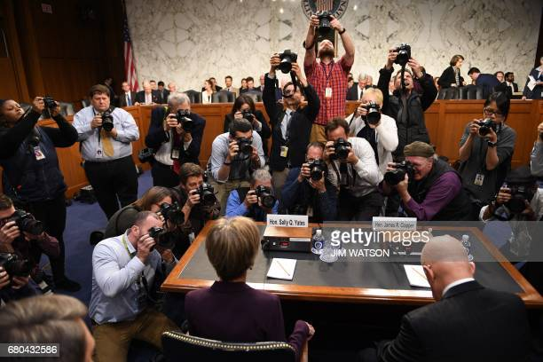 Former acting Attorney General Sally Yates and former Director of National Intelligence James Clapper prepare to testify on May 8 before the US...
